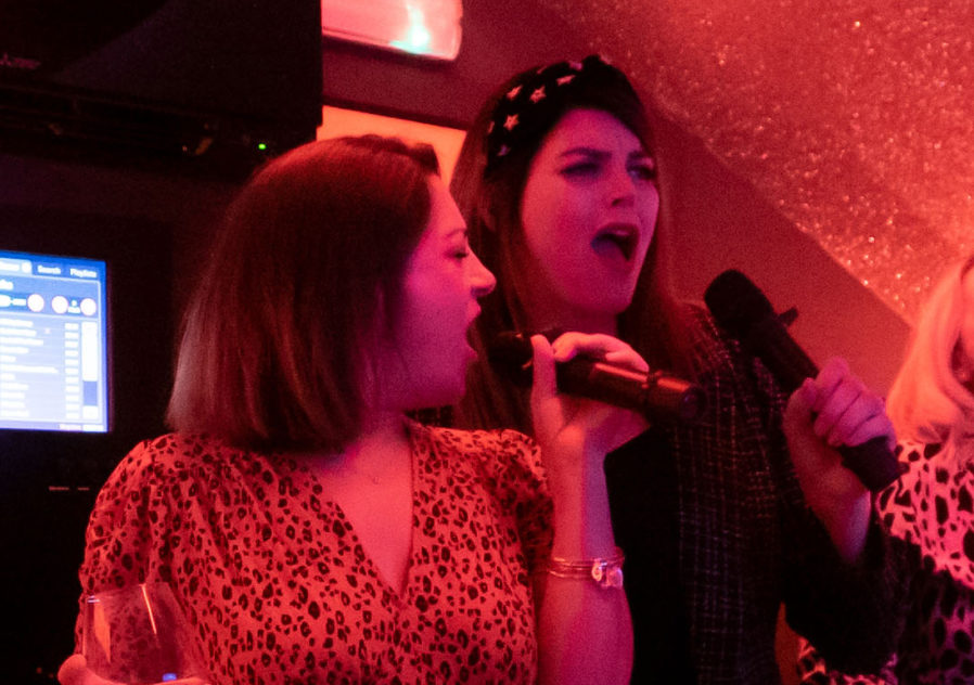 born noisy group of ladies singing in our private karaoke pod