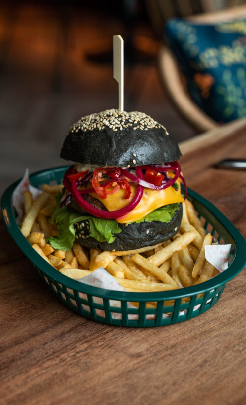 Garum marinaded beef pattie, charcoal brioche bun, American cheese, pickles, chimichurri mayo| Iceberg lettuce, Asian slaw, united fries